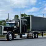 Black semi with enclosed trailer
